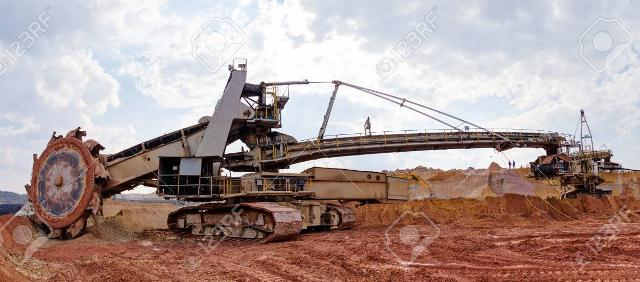 open mining pit with heavy machinery