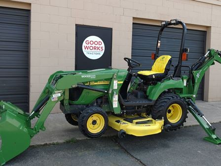 Riding Lawn Mower with Backhoe Attachment